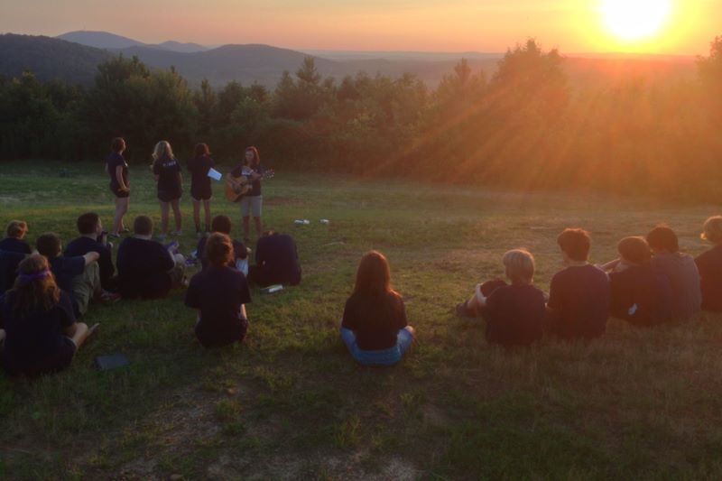 Worship service on the mountain at sunset.
